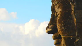 Zoom Out of Stone Carving of Buddha's Face on Temple Wall - Angkor Wat Temple Cambodia. Sand Stone Carving of Buddha stock footage