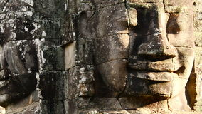 Zoom out-  Stone Carving of Two Headed Buddha Goddess on Temple Wall - Angkor Wat, Cambodia stock video