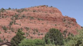 Arizona, Sedona, A zoom out from Sugarloaf Mountain with a house in the foreground