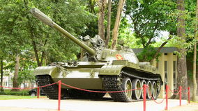 Zoom Out - Tank at the Independence Palace - Ho Chi Minh City. Famous tank that smashes through Palace Gates to end the Vietnam War stock footage