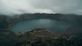 Zoom out time lapse over the Quilotoa crater in Ecuador. stock video