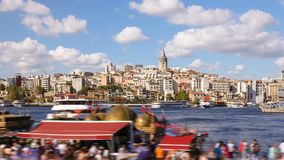 Zoom out timelapse of people walking around famoust tourist place in Istanbul with Galata Tower view and Bosphorus. Zoom out timelapse of people walking around stock video