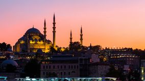 Zoom out Timelapse view of Suleymaniye mosque with tourist ships floating at Bosphorus in Istanbul at night stock video
