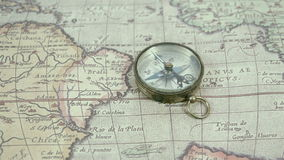 Zoom out view of the compass and the map stock video