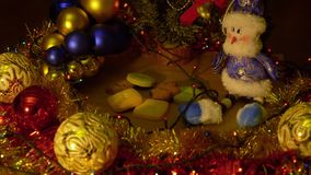 Zoom out zooming close up indoors. Christmas and New Year Decoration. Abstract Blurred Bokeh Holiday Background. Blinking Garland. Christmas Tree Lights stock footage