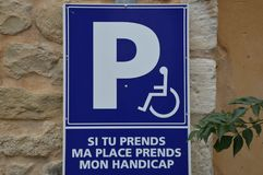 Zoom on a park sign in france. Handicap Royalty Free Stock Photos