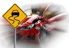 Zoom on a red car accident with danger yellow sign Royalty Free Stock Image