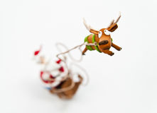 Zoom in reindeer with Santa Claus riding on sleigh Stock Photo
