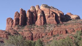 Arizona, Sedona, A zoom in on rock formation in Sedona with trees and desert landscape