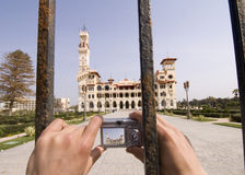 Zoom shot of Al-Montazah Palace. A tourist is taking a photo to the closed Al-Montazah Palace in alexandria city, egypt Stock Photo