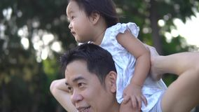 Zoom in slow motion of Asian Father and young baby girl stock video
