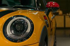 Zoom sports car headlight in Car show event Stock Image