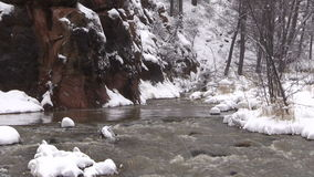 Zoom In of a Stream in Winter stock footage