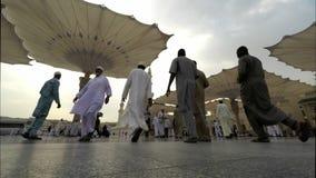 Zoom in Time Lapse in Medina Saudi Arabia Muslim believers praying stock video