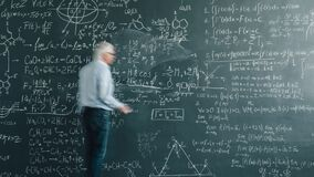 Zoom-in time lapse of senior man scientist writing calculations on blackboard
