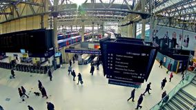 Zoom timelapse of Commuters inside Waterloo Railway Station in London stock footage