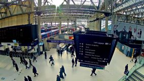 Zoom timelapse of Commuters inside Waterloo Railway Station in London. LONDON, UNITED KINGDOM - DECEMBER 9, 2013: Top view zoom timelapse of Commuters inside stock footage