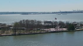 Zoom to american flag at statue of liberty monument stock footage
