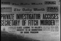 Zoom in  to newspaper headline stock video