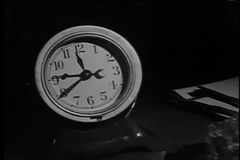 Zoom in to table clock at 11:40 stock video footage