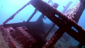 Zoom in to wreck on the sea sandy bottom stock footage