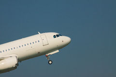 Zoom up front veiw of passenger jet plane take off to flying fro Stock Images