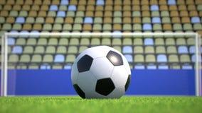 Zoom-ut till en fotbollboll som ligger på gräset i en tom stadion arkivfilmer