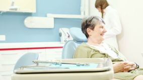 Zoom in view of elderly female patient sitting in dental chair