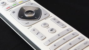 Zoom in on a white remote control stock video footage