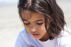Zoom of young girl playing Royalty Free Stock Images
