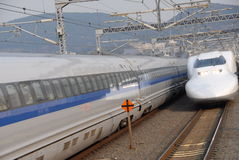 Zoom zoom. Shinkansen bullet train zooming past Stock Image