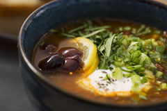 Zoomed bowl with soup with beans Stock Images