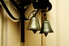 Zoomed foto of hanging metallic colored bells Stock Photography