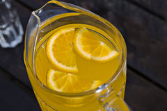 Zoomed juice of orange with pieces Royalty Free Stock Photos