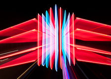 Zoomed neon sign. A zoom effect on a lit neon sign creates a futuristic three-dimensional shape Royalty Free Stock Photos