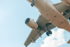 Zoomed view of airplane in the sky Stock Photography