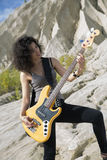 Zoomed view of woman with guitar Stock Photography