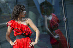 Zoomed woman in wet dress reflect. At day Royalty Free Stock Photo