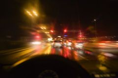 Zoomin' through street. Car driving through city at night Royalty Free Stock Images