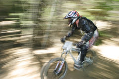 Zoomin' through the trees. MTB racing Stock Photo
