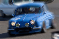 Zooming on a blue rally car. Royalty Free Stock Images