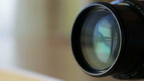 Zooming lens when shooting with camera. stock video footage