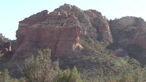 Arizona, Sedona, Zooming out from a beautiful rock formation surrounded by trees and desert