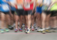 Zooming on runner shoes. At race start Stock Photos