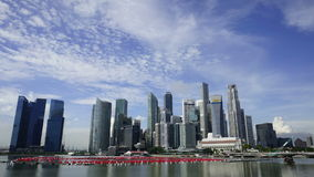 Zooming in on Singapore CBD Landscape with moving clouds stock video footage