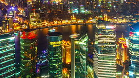 Zooming time-lapse of aerial night illuminated cityscape, Shanghai China. stock video footage