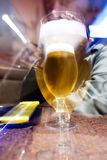 Zooming to bier. Lens zooming to drunk man behind Glass of beer Stock Photos