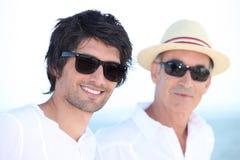 Zoon en vader in de zomer Royalty-vrije Stock Afbeeldingen