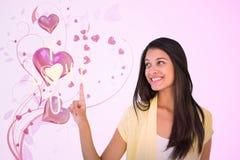 Złożony wizerunek szczęśliwa przypadkowa kobieta wskazuje up Obraz Royalty Free