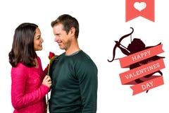 Złożony wizerunek uśmiechnięta para z czerwieni różą Zdjęcia Stock
